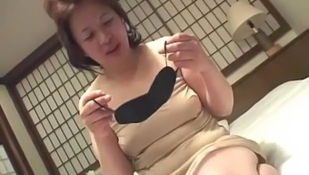 Asian Granny Inserts A Vibrator In Her Pussy