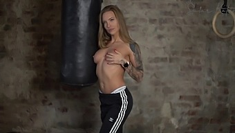 Tattoed Fit Blonde Masturbating In Gym Cycling Dildo And Having Orgasms