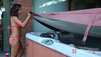 Asian Dominatrix Lucy Khan'S Latex Hot Tub Gimp